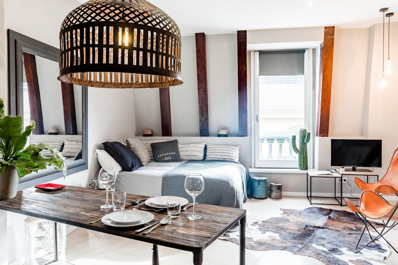 """<p>Studio apartments are perfect for solo travelers, especially when they're <a href=""""https://www.cntraveler.com/gallery/what-a-dollar100-airbnb-looks-like-around-the-world?mbid=synd_yahoo_rss"""" target=""""_blank"""">under $100 per night</a>. This 430-square-foot <a href=""""https://www.cntraveler.com/story/airbnb-plus-is-for-people-who-hate-airbnb?mbid=synd_yahoo_rss"""" target=""""_blank"""">Airbnb Plus</a> is steps away from Las Ramblas, giving you easy, walkable access to most of Barcelona's major sites and a mainline into the Gothic Quarter. It offers secure keyless entry, a combined washer/dryer, reliable Wi-Fi, and a dining table can easily serve as desk space for Barcelona-bound business travelers. Yes, the bedroom and the kitchen are in the same room, but for one person, there's plenty of space to spread out.</p> <p><strong>Book Now:</strong> <a href=""""http://airbnb.pvxt.net/g5E3B"""" rel=""""nofollow"""" target=""""_blank"""">From $88 per night, airbnb.com</a></p>"""