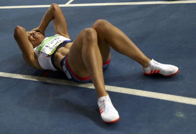 2016 Rio Olympics - Athletics - Final - Women's Heptathlon 800m - Olympic Stadium - Rio de Janeiro, Brazil - 13/08/2016. Jessica Ennis-Hill (GBR) of Britain reacts after the race. REUTERS/Kai Pfaffenbach FOR EDITORIAL USE ONLY. NOT FOR SALE FOR MARKETING OR ADVERTISING CAMPAIGNS.