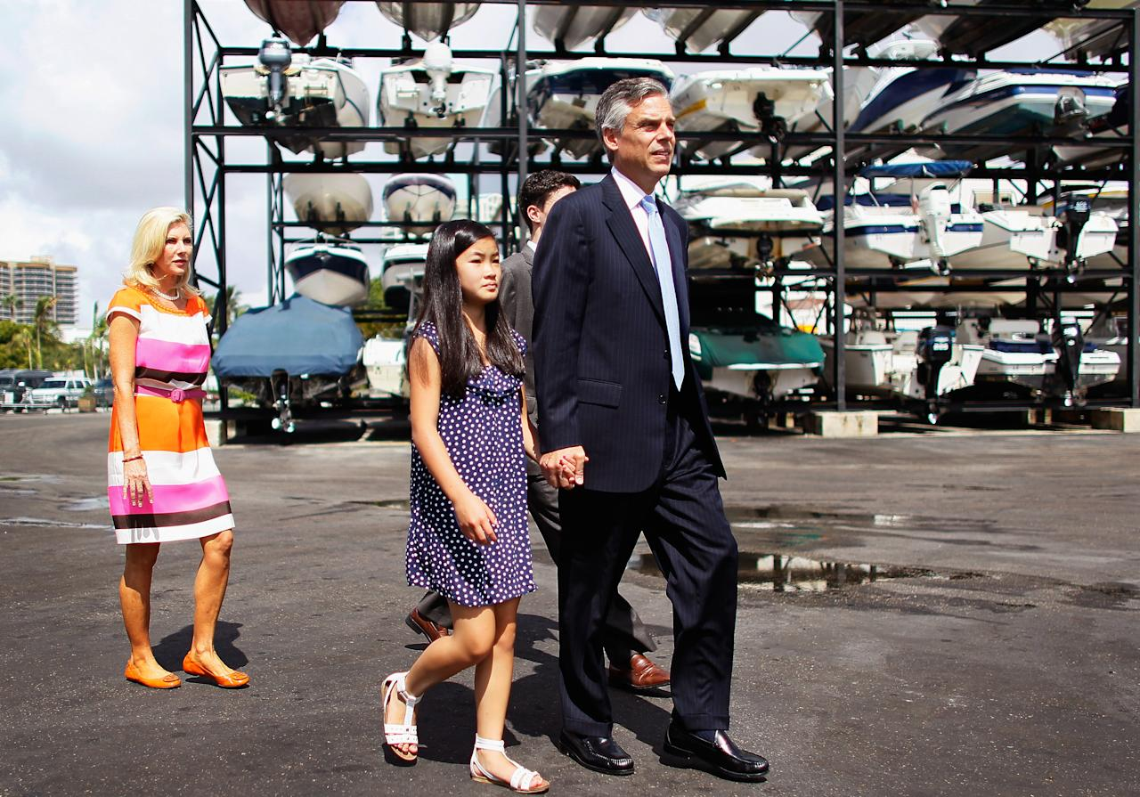 MIAMI, FL - AUGUST 10:  (R-L) Republican Presidential candidate Jon Huntsman walks with his daughter, Gracie Mei Huntsman, and wife Mary Kaye Huntsman before holding a press conference at Scotty's Landing restaurant on August 10, 2011 in Miami, Florida. Huntsman, former Ambassador to China, used the press conference to announce the endorsement of his candidacy by Jeb Bush, Jr. and political strategist Ana Navarro as he campaigns across the country. (Photo by Joe Raedle/Getty Images)
