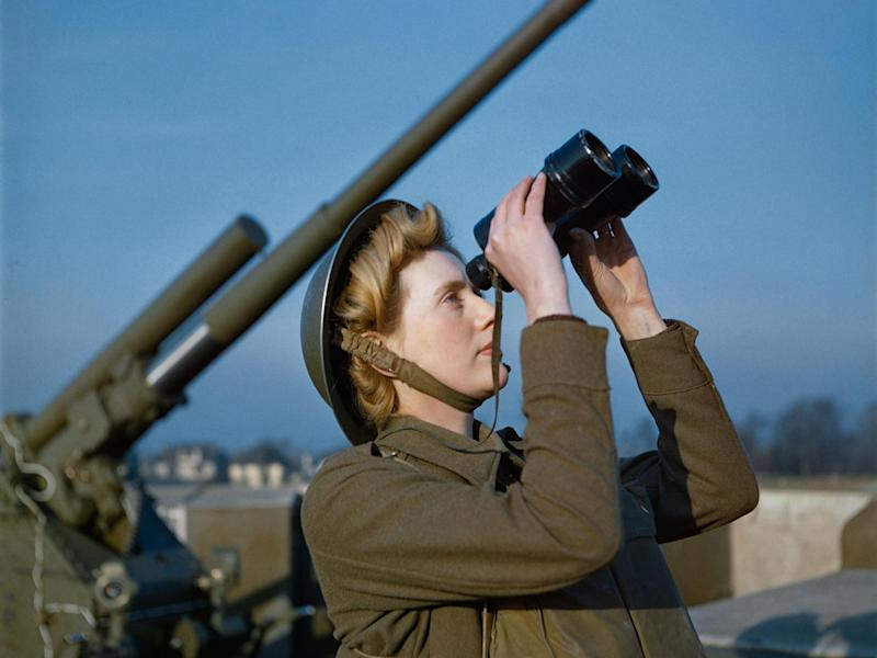 An Auxiliary Territorial Service (ATS) 'spotter' at a 3.7-inch anti-aircraft gun site, December 1942. The photo - taken on colour film - is one of a rare collection which has been released by the Imperial War Museum: Imperial War Museum
