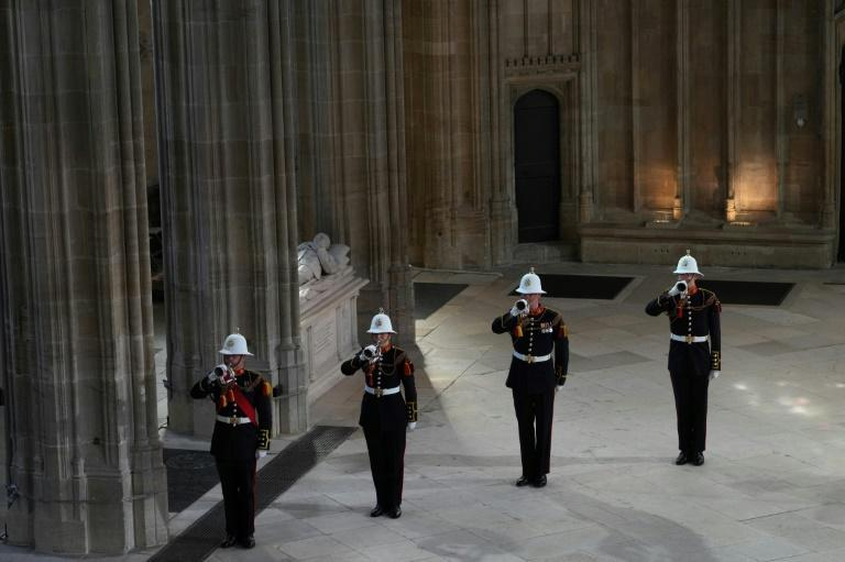 The Pipe Major of the Royal Regiment of Scotland played a lament, and buglers of the Royal Marines sounded The Last Post