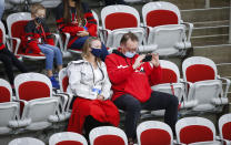 Family members watch the action during the second period of an IIHF women's hockey championship game between Canada and Finland in Calgary, Alberta, Friday, Aug. 20, 2021. (Jeff McIntosh/The Canadian Press via AP)