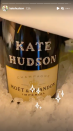 <p>Was she celebrating the Met Gala or her engagement? Either way, we're loving this embellished bottle of champers. </p>