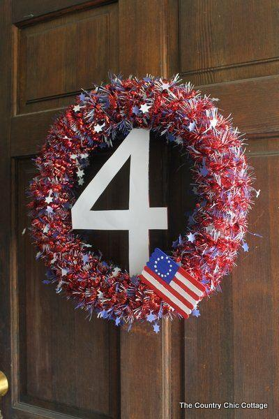 """<p>This ingenious design repurposes a poodle noodle to create the wreath's base, then adds tinsel and a flag of painted popsicle sticks. </p><p><strong>Get the tutorial at <a href=""""https://www.thecountrychiccottage.net/wreath-for-4th-of-july/"""" rel=""""nofollow noopener"""" target=""""_blank"""" data-ylk=""""slk:The Chic Country Cottage"""" class=""""link rapid-noclick-resp"""">The Chic Country Cottage</a>. </strong></p><p><a class=""""link rapid-noclick-resp"""" href=""""https://www.amazon.com/Patriotic-American-Metallic-Independence-Decoration/dp/B091V8H547/ref=sr_1_15?dchild=1&keywords=fourth+of+july+tinsel&qid=1622035008&sr=8-15&tag=syn-yahoo-20&ascsubtag=%5Bartid%7C10050.g.4464%5Bsrc%7Cyahoo-us"""" rel=""""nofollow noopener"""" target=""""_blank"""" data-ylk=""""slk:SHOP TINSEL"""">SHOP TINSEL</a></p>"""