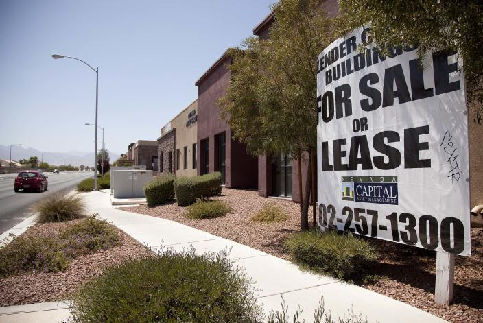 A sign advertising empty professional office space for sale or lease is posted outside a building Thursday, June 21, 2012, in North Las Vegas, Nev. Despite its suburban trimmings, this blue-collar, family-oriented city outside Las Vegas is officially a disaster area. Faced with an unrelenting tide of foreclosures and bankruptcies, Nevada has the highest unemployment rate in the nation. North Las Vegas is among its hardest-hit cities, with the state threatening to take it over every few months. (AP Photo/Julie Jacobson)