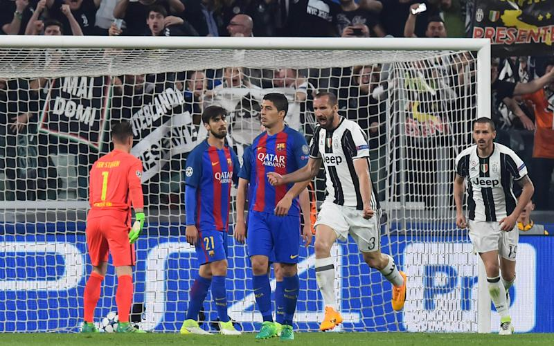 Juventus' defender from Italy Giorgio Chiellini (2ndR) celebrates after scoring next to Barcelona's Uruguayan forward Luis Suarez during the UEFA Champions League quarter final first leg football match Juventus vs Barcelona - Credit: AFP