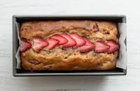 """<p>There are <a href=""""https://www.thedailymeal.com/cook/how-to-make-banana-bread-recipe?referrer=yahoo&category=beauty_food&include_utm=1&utm_medium=referral&utm_source=yahoo&utm_campaign=feed"""" rel=""""nofollow noopener"""" target=""""_blank"""" data-ylk=""""slk:plenty of ways to make banana bread"""" class=""""link rapid-noclick-resp"""">plenty of ways to make banana bread</a>. You can take the fruity route with this strawberry banana bread recipe. This bread tastes indulgent but is low in fat because Greek yogurt takes the place of butter without compromising the moisture in the bread.</p> <p><a href=""""https://www.thedailymeal.com/recipes/strawberry-banana-bread-recipe?referrer=yahoo&category=beauty_food&include_utm=1&utm_medium=referral&utm_source=yahoo&utm_campaign=feed"""" rel=""""nofollow noopener"""" target=""""_blank"""" data-ylk=""""slk:For the Strawberry Banana Bread recipe, click here."""" class=""""link rapid-noclick-resp"""">For the Strawberry Banana Bread recipe, click here.</a></p>"""