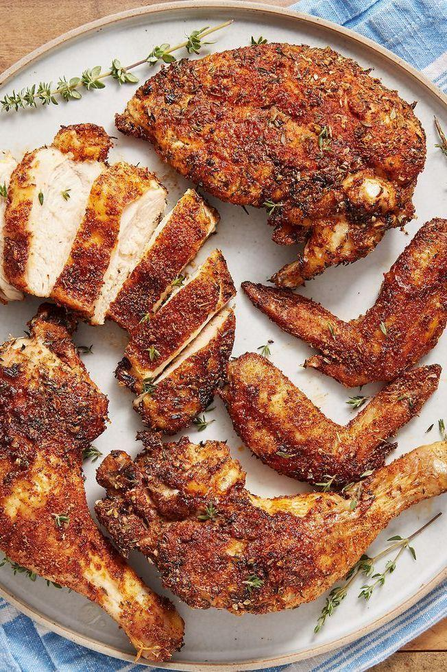 """<p>We love a good <a href=""""https://www.delish.com/uk/cooking/recipes/a28926109/classic-roast-chicken-recipe/"""" rel=""""nofollow noopener"""" target=""""_blank"""" data-ylk=""""slk:Classic Roasted Chicken"""" class=""""link rapid-noclick-resp"""">Classic Roasted Chicken</a>, but it's not always practical for a weeknight dinner. This easy air fryer recipe takes most of the waiting out of roasting a chicken, with remarkably similar results. We found that even when we cooked our chicken well past 73°C, it was still juicy and not at all dry. <a href=""""https://www.delish.com/uk/kitchen-accessories/g31784513/best-air-fryer/"""" rel=""""nofollow noopener"""" target=""""_blank"""" data-ylk=""""slk:Air fryer"""" class=""""link rapid-noclick-resp"""">Air fryer</a>, we love you.</p><p>Get the <a href=""""https://www.delish.com/uk/cooking/recipes/a34367289/air-fryer-rotisserie-chicken/"""" rel=""""nofollow noopener"""" target=""""_blank"""" data-ylk=""""slk:Air Fryer Rotisserie Chicken"""" class=""""link rapid-noclick-resp"""">Air Fryer Rotisserie Chicken</a> recipe.</p>"""