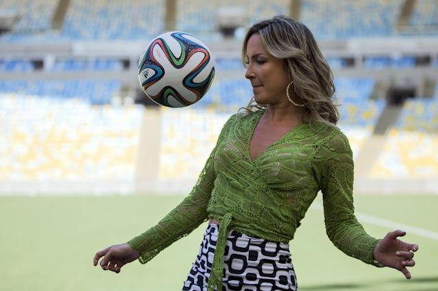Brazilian singer Claudia Leitte plays with a soccer ball as she poses for photos at the Maracana stadium in Rio de Janeiro, Brazil, Thursday, Jan. 23, 2014. Claudia Leitte will perform with Jennifer Lopez and rapper Pitbull the official song for the 2014 World Cup. Football's governing body didn't elaborate when the song, written and co-produced by Pitbull will be released. (AP Photo/Felipe Dana)
