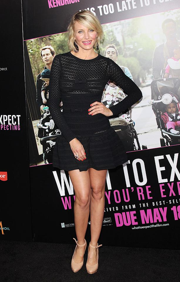 "Cameron Diaz, 39, donned a black sheer design, which showcased her toned legs, at the premiere of her movie ""What to Expect When You're Expecting"" in L.A. this month. (5/14/2012)"