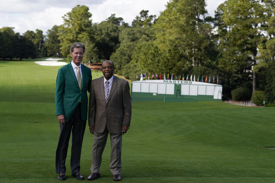 Lee Elder, right, and Fred Ridley, Chairman of Augusta National Golf Club posed for a picture on the first tee at the Masters golf tournament Monday, Nov. 9, 2020, in Augusta, Ga. Fred Ridley, Chairman of Augusta National Golf Club, announced today that Lee Elder, the first Black man to compete in the Masters Tournament 45 years ago, will be honored by establishing scholarships in his name and inviting him to be an Honorary Starter for the 2021 Masters. (AP Photo/Chris Carlson)