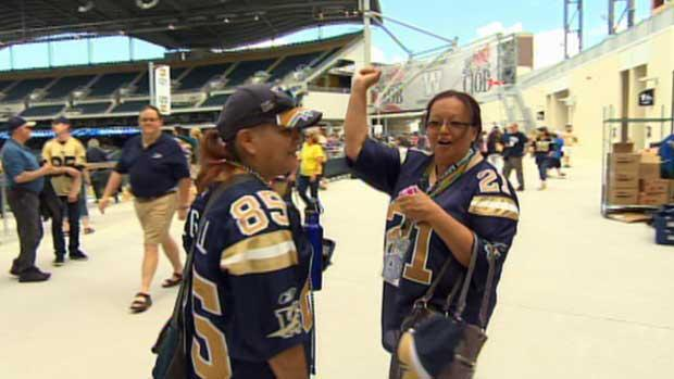 Winnipeg Blue Bombers fans celebrate the team's first game at Investors Group Field on Wednesday evening.