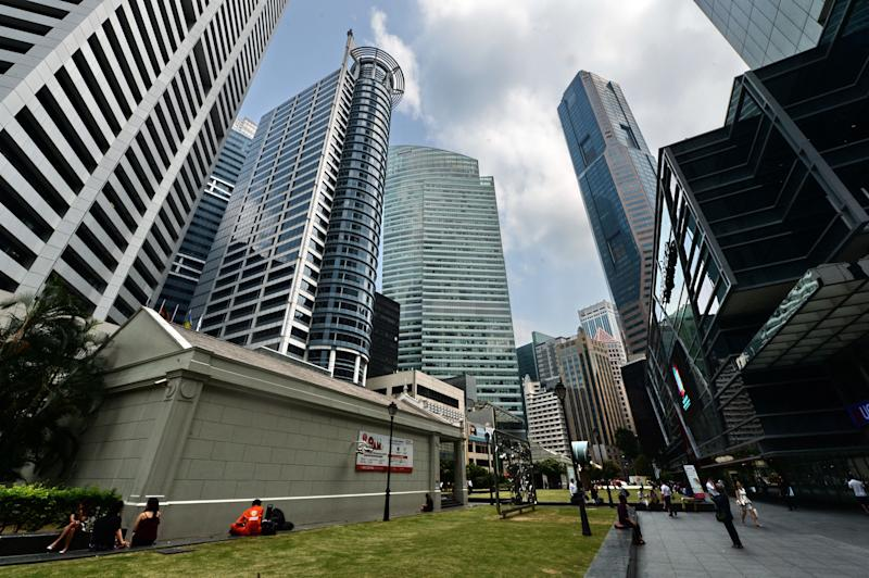 A general view of the Raffles Place financial district in Singapore on March 31, 2016. Credit ratings firm Moody's on March 31 downgraded its outlook for Singapore banks to negative from stable, citing risks arising from the slowdown in the domestic and regional economies / AFP PHOTO / ROSLAN RAHMAN (Photo credit should read ROSLAN RAHMAN/AFP via Getty Images)