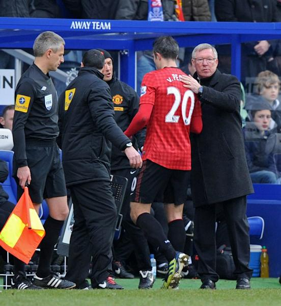 Manchester United's Dutch striker Robin van Persie is substituted after picking up an injury in the 2-0 win at QPR, on February 23, 2013. Van Persie tumbed into the photographers' pit behind one goal, sustaining a hip injury that forced him off four minutes before half-time