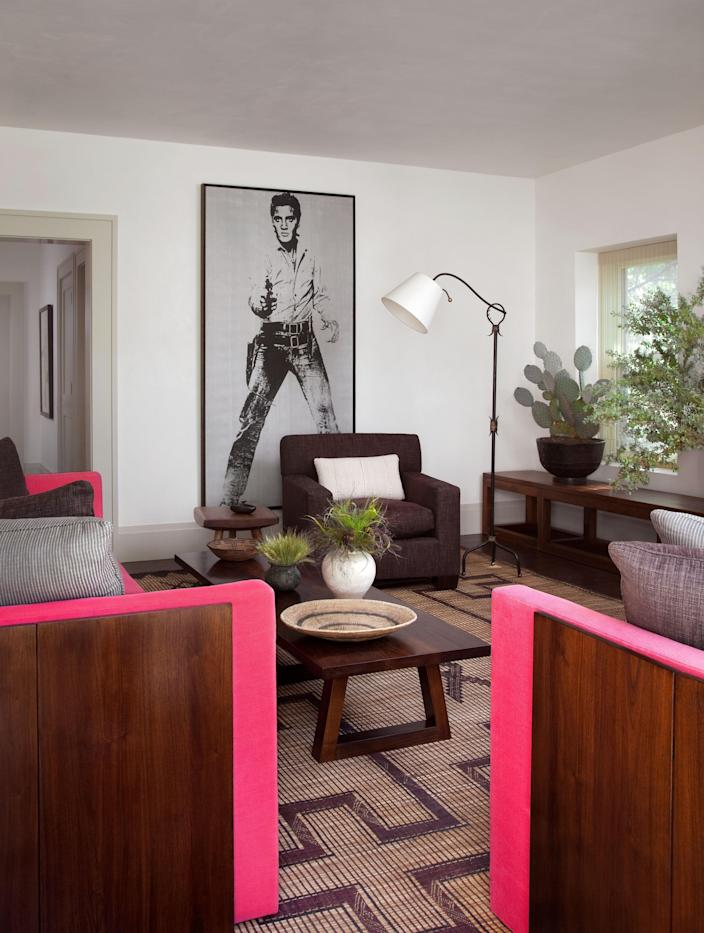 """<div class=""""caption""""> An unsigned Andy Warhol <em>Elvis</em> from the collection of Joe D'Allesandro commands the living room. </div>"""