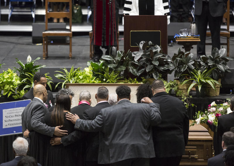 "Family members gather around the casket of Katherine Johnson at the start of a memorial service in her honor on Saturday, March 7, 2020, at Hampton University Convocation Center in Hampton, Va.   Johnson, a mathematician who calculated rocket trajectories and earth orbits for NASA's early space missions and was later portrayed in the 2016 hit film ""Hidden Figures,"" about pioneering black female aerospace workers  died on Monday, Feb. 24, 2020. She was 101. (Kaitlin McKeown /The Virginian-Pilot via AP)"