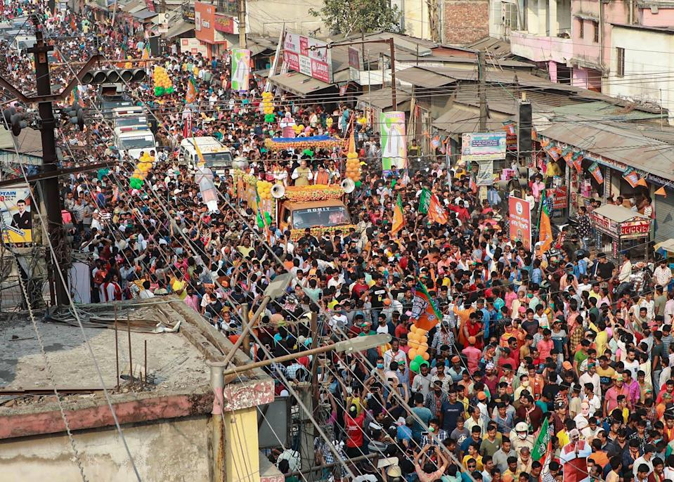 Islampur: Union Home Minister and senior BJP leader Amit Shah during an election campaign roadshow for party candidates in Islampur on Tuesday, 13 April.
