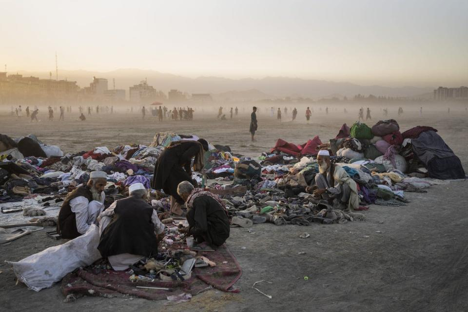 Afghans sort through second-hand clothes