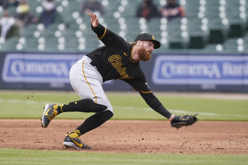 Pittsburgh Pirates first baseman Colin Moran fields the grounder hit by Detroit Tigers' Willi Castro during the third inning of a baseball game, hursday, April 22, 2021, in Detroit. (AP Photo/Carlos Osorio)