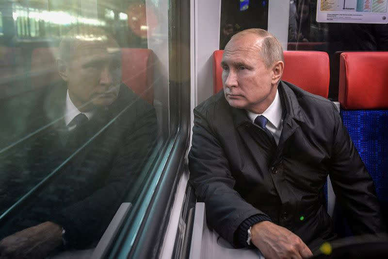 'Are you real?' Putin quashes rumours he uses a body double
