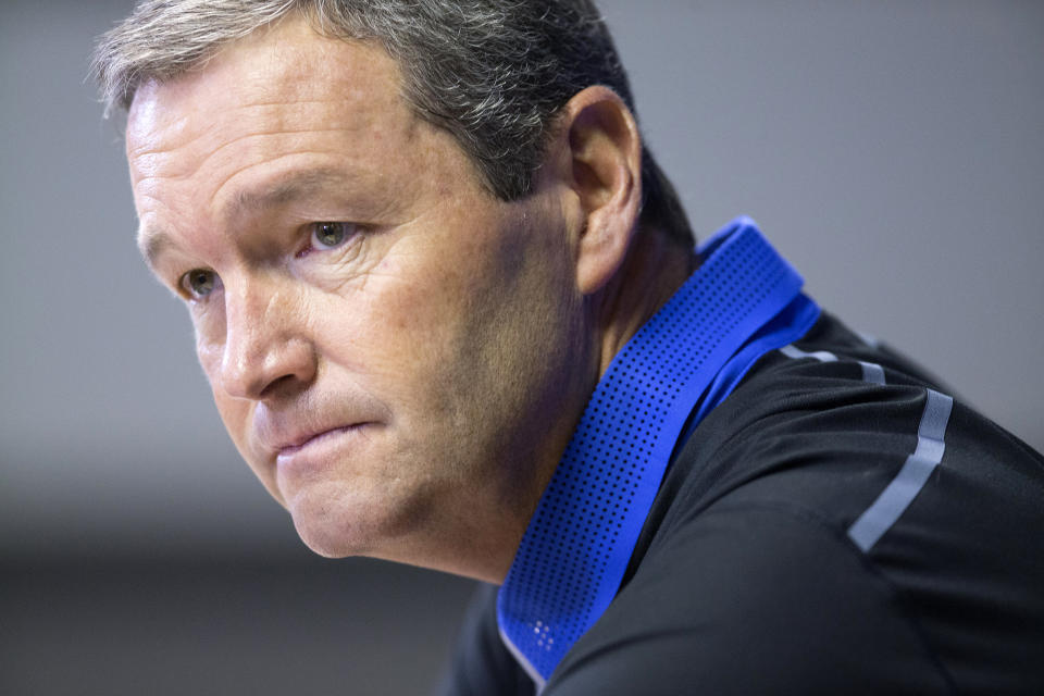 Kentucky's Director of Athletics Mitch Barnhart speaks to reporters during the team's annual NCAA college football media day at Commonwealth Stadium in Lexington, Ky., Friday, Aug. 7, 2015. (AP Photo/ David Stephenson)