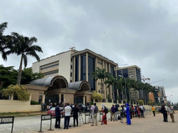 Journalists are seen stationed opposite the Federal High Court as they await the arrival of IPOB leader Nnamdi Kanu at the court in Abuja