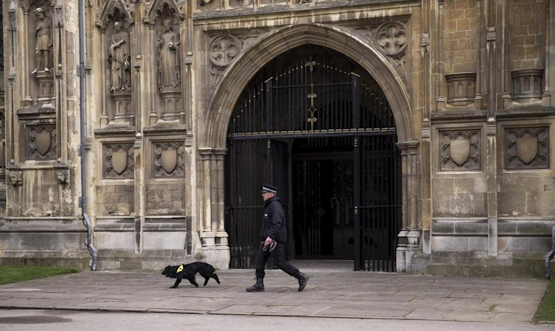 A police officer and his dog perform a security sweep before the enthronement ceremony of Britain's new Archbishop of Canterbury Justin Welby at Canterbury Cathedral in Canterbury, England, Thursday, March 21, 2013. Welby is to be formally enthroned at Canterbury Cathedral before statesmen and religious leaders Thursday. He is the 105th Archbishop of Canterbury and serves as head of the Church of England and spiritual leader of the world's Anglican Communion. (AP Photo/Matt Dunham)