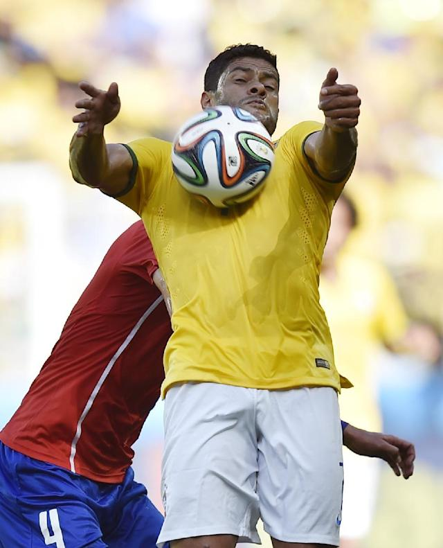 Brazil's Hulk controls the ball on his chest during the World Cup round of 16 soccer match between Brazil and Chile at the Mineirao Stadium in Belo Horizonte, Brazil, Saturday, June 28, 2014. (AP Photo/Martin Meissner)