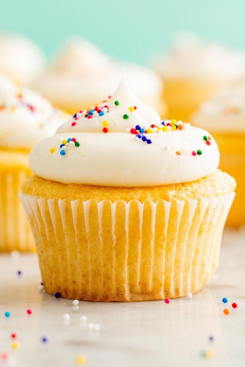 """<p>This will become your go-to cupcake recipe - guaranteed! </p><p>Get the <a href=""""https://www.delish.com/uk/cooking/recipes/a28829469/perfect-vanilla-cupcakes-recipe/"""" rel=""""nofollow noopener"""" target=""""_blank"""" data-ylk=""""slk:Vanilla Cupcakes"""" class=""""link rapid-noclick-resp"""">Vanilla Cupcakes</a> recipe. </p>"""