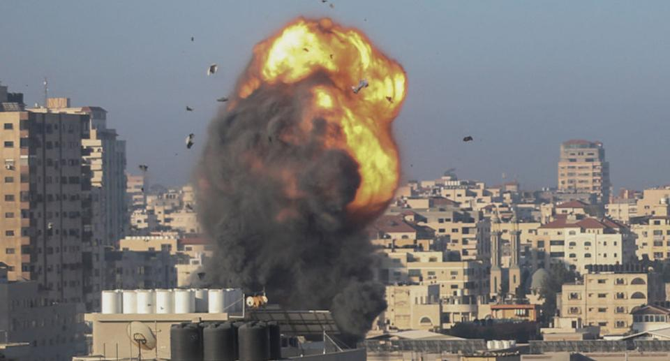 A fireball and smoke billow up into the air during an Israeli airstrike on Gaza City targeting the Ansar compound, linked to the Hamas movement, in the Gaza Strip early on May 15, 2021.