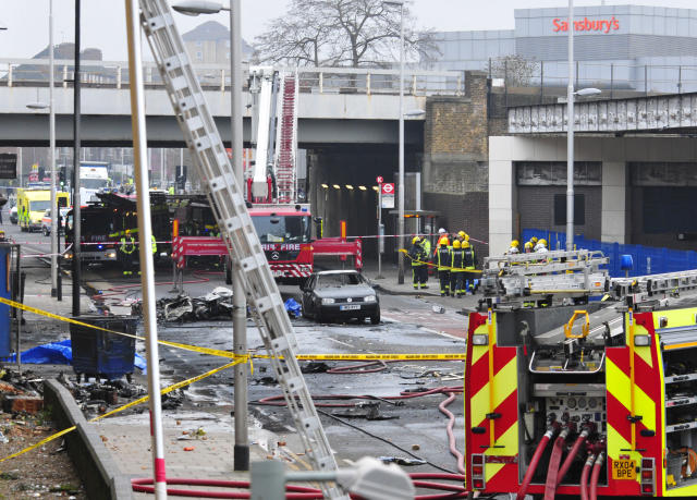 Debris lies on the ground after a helicopter crashed into a construction crane on top of St George's Wharf tower building, in London, Wednesday Jan. 16, 2013. Police say two people were killed when a helicopter crashed during rush hour in central London after apparently hitting a construction crane on top of a building. (AP Photo/Vince Pol)