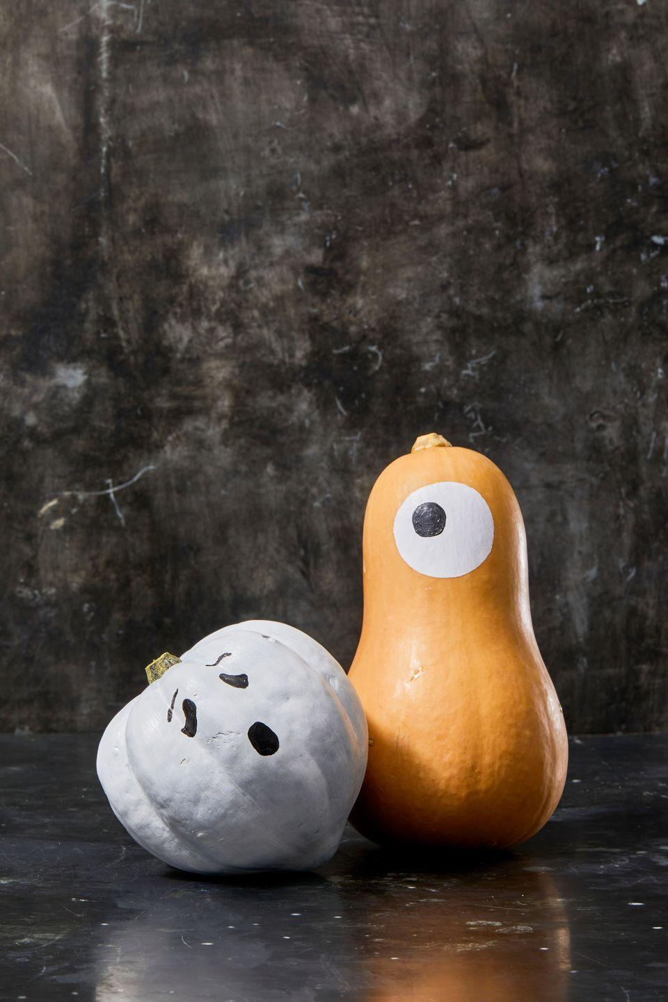 "<p>These super-cute painted ghosts aren't pumpkins at all, but that doesn't make them any less festive. Play around with different shapes from your grocery store or farmer's market, and add cute, playful faces.</p><p><a class=""link rapid-noclick-resp"" href=""https://www.amazon.com/Apple-Barrel-Acrylic-PROMOABI-Assorted/dp/B00ATJSD8I/ref=asc_df_B00ATJSD8I/?tag=syn-yahoo-20&ascsubtag=%5Bartid%7C10055.g.1714%5Bsrc%7Cyahoo-us"" rel=""nofollow noopener"" target=""_blank"" data-ylk=""slk:SHOP ACRYLIC PAINT"">SHOP ACRYLIC PAINT </a></p>"