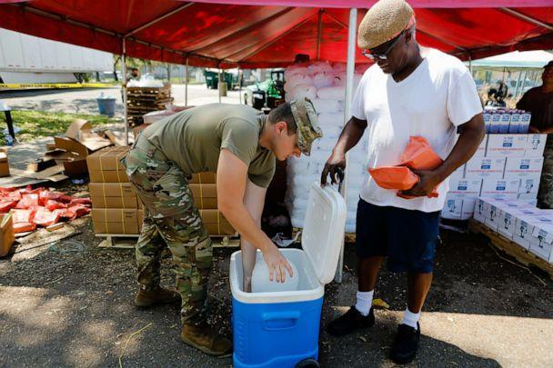 PHOTO: Members of the National Guard hand out supplies at a distribution center after Hurricane Ida in New Orleans, Sept. 3, 2021. (Eva Marie Uzcategui/Bloomberg via Getty Images)