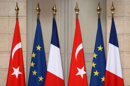 Flags of Turkey, France and the European Union are seen during a joint press conference attended by  the French and Turkish presidents at the Elysee Palace in Paris, France, January 5, 2018.   REUTERS/Ludovic Marin/Pool