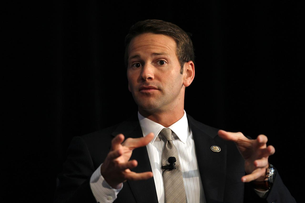 Illinois Rep. Aaron Schock speaks on the panel at the George W. Bush Institute forum at the Art Institute in Chicago in September 2012. Schock resigned Tuesday amid controversy over his spending habits. (Nancy Stone/Chicago Tribune/Tribune News Service via Getty Images)