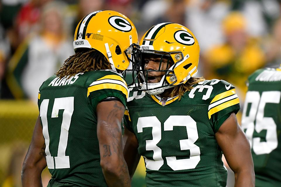 GREEN BAY, WISCONSIN - SEPTEMBER 26: Davante Adams #17 and Aaron Jones #33 of the Green Bay Packers celebrate against the Philadelphia Eagles at Lambeau Field on September 26, 2019 in Green Bay, Wisconsin. (Photo by Quinn Harris/Getty Images)