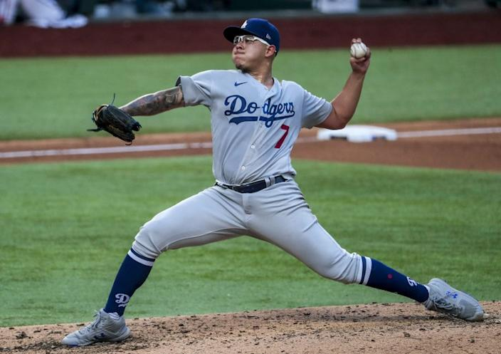 Arlington, Texas, Wednesday, October 14, 2020. Los Angeles Dodgers starting pitcher Julio Urias (7) pitches the fourth inning in game three of the NLCS at Globe Life Field. (Robert Gauthier/ Los Angeles Times)