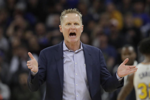 Golden State Warriors head coach Steve Kerr gestures toward an official during the first half of his team's NBA basketball game against the Toronto Raptors in San Francisco, Thursday, March 5, 2020. (AP Photo/Jeff Chiu)