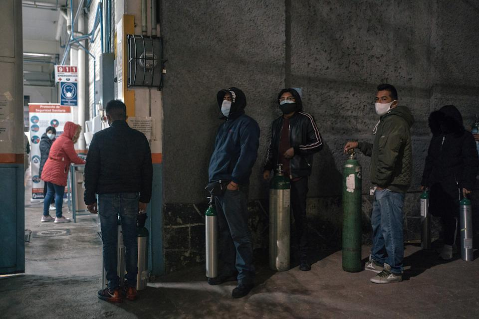 People line up to fill oxygen tanks at a government certified private provider in Mexico City on Wednesday, Feb. 3, 2021. With hospitals overrun, Mexicans fighting the coronavirus at home face a deadly hurdle: a lack of oxygen tanks. (Luis Antonio Rojas/The New York Times)