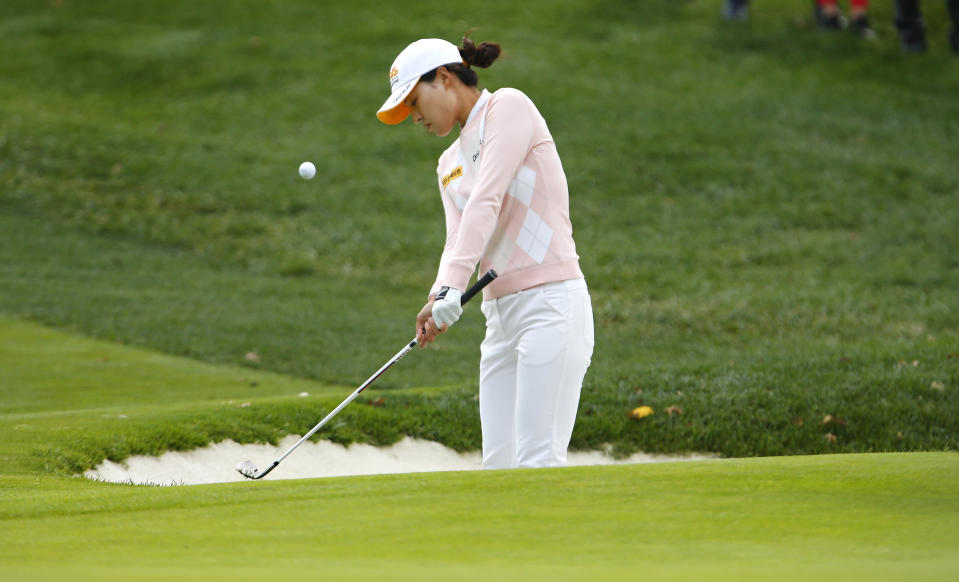 In Gee Chun hits out of a bunker at the first hole during the third round of the Cognizant Founders Cup golf tournament Saturday, Oct. 9, 2021, in West Caldwell, N.J. (AP Photo/Noah K. Murray)