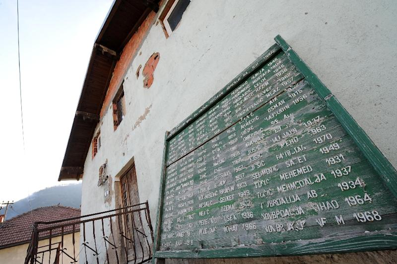 Names of victims in Bosnia's 1992-1995 inter-ethnic war are etched on a board by an empty house in the village of Divic, in the Zvornik district, on March 28, 2012