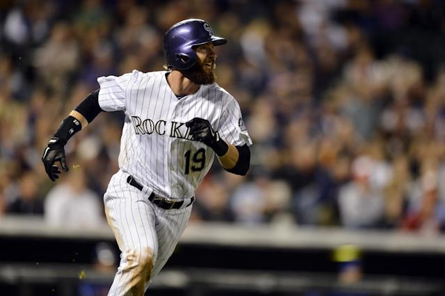 Colorado Rockies' Charlie Blackmon watches the flight of a solo home run against the New York Mets during the seventh inning of a baseball game, Friday, May 2, 2014, in Denver. (AP Photo/Jack Dempsey)