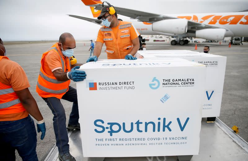 FILE PHOTO: Workers take care of the shipment of Russia's Sputnik V vaccine at the airport, in Caracas