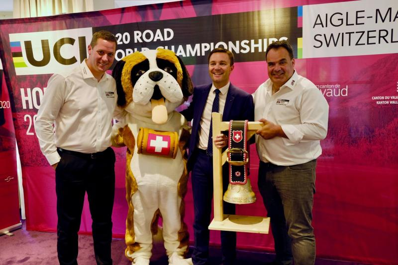 2020 UCI Road World Championships organisers Alexandre Debons and Grégory Devaud with UCI president David Lappartient – and event mascot Barry the St. Bernard – at the unveiling of the championships' routes