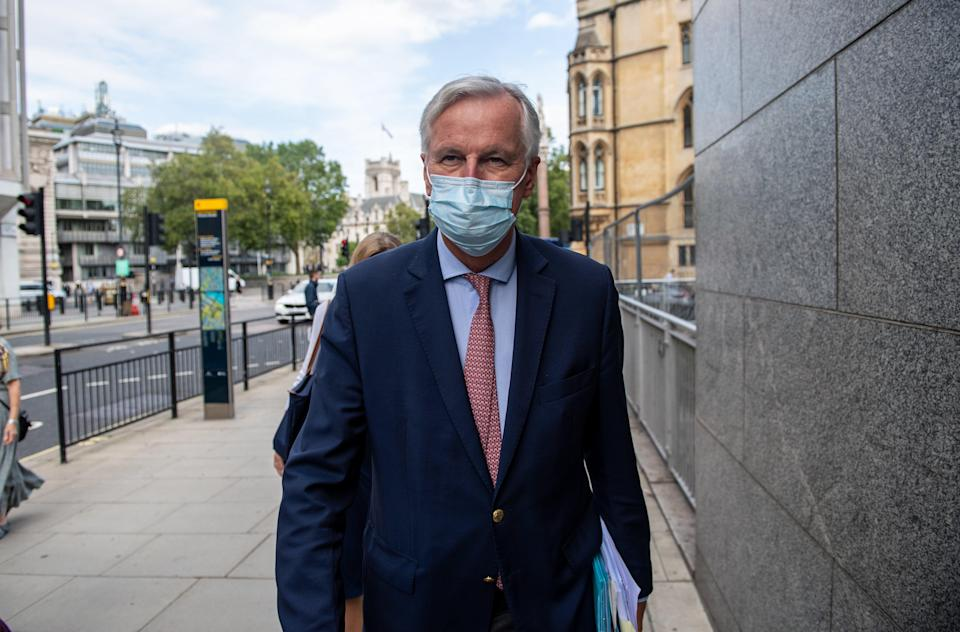 Michel Barnier, The European Union's chief negotiator, arrives with members of his team for talks in London during a previous round (Getty Images)