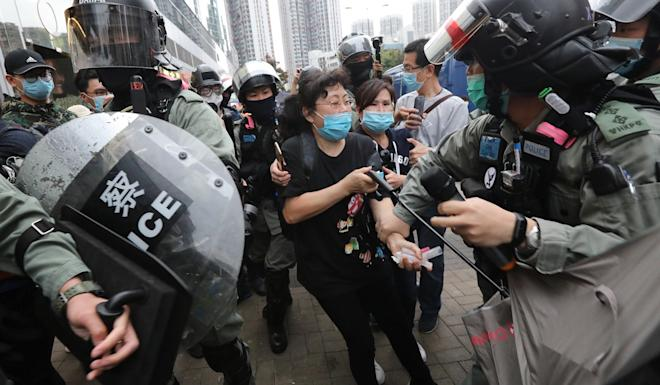 A police officer grabs a protester during a confrontation in Tin Shui Wai. Photo: Felix Wong