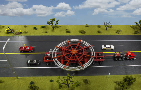 A model of the truck that will be used to transport the Muon g-2 ring, placed on a streetscape for scale. The truck will be escorted by police and other vehicles when it moves from Brookhaven National Laboratory in New York to a barge, and then