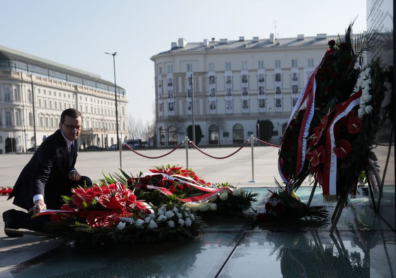 Poland's Prime Minister Mateusz Morawiecki lays a wreath on the monument to the victims of the Smolensk air disaster