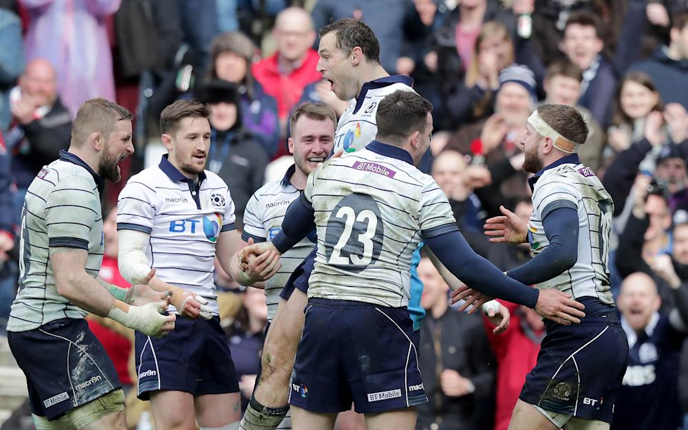Scotland's Tim Visser celebrates scoring a try - Credit: REX