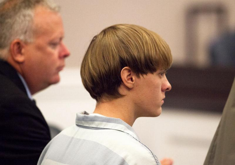Dylann Roof, right, 21, listens to proceeding with assistant defense attorney William Maguire during a hearing at the Judicial Center July 16, 2015 in Charleston, South Carolina. Roof is charged with murdering nine worshippers at a historic black church in Charleston last month.